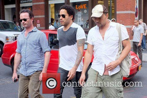 Lenny Kravitz walking with friends in the East...