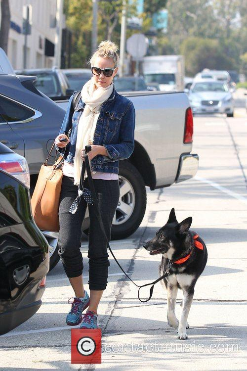 Leslie Bibb out and about with her dog...