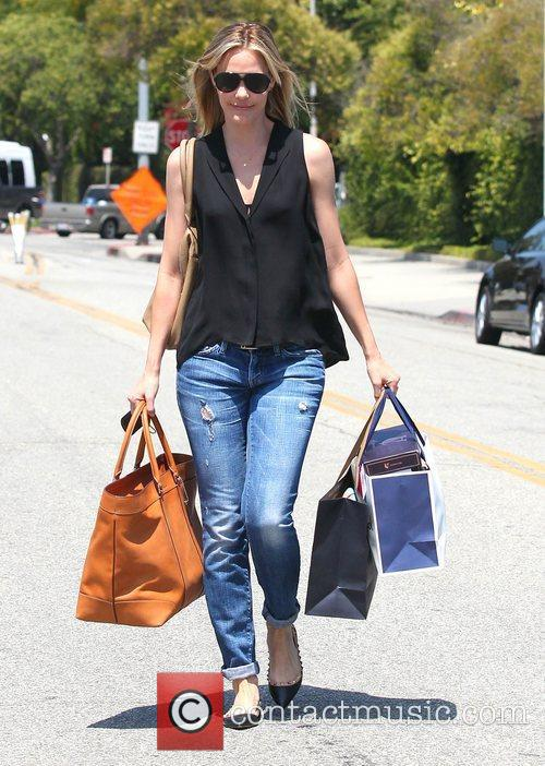 Leslie Bibb leaves a gifting suite in Beverly...