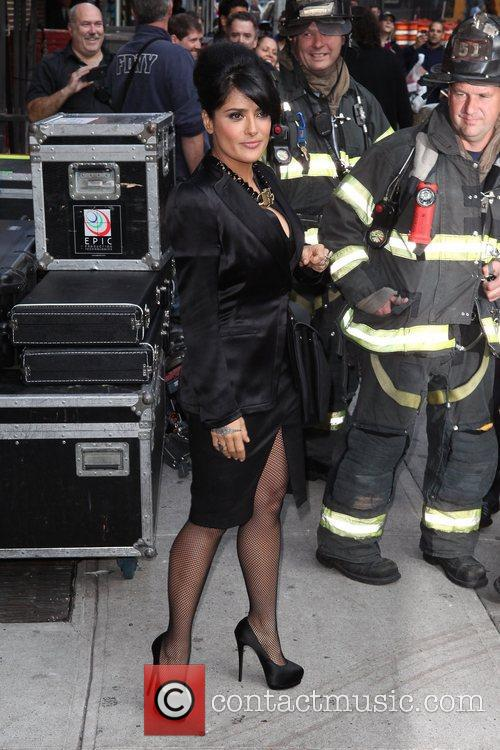 Salma Hayek posing with firefighters 'The Late Show...