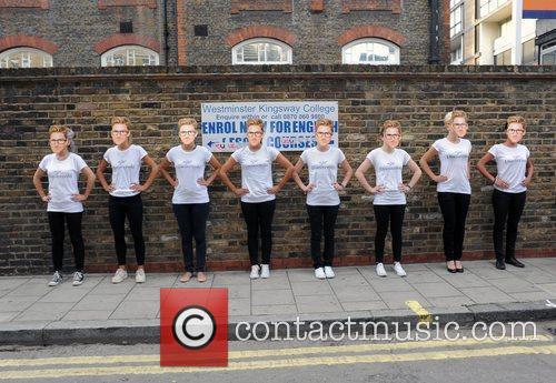 Models wearing Henry Holland masks London Fashion Week...