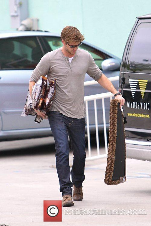 Liam Hemsworth picks up some supplies at a...