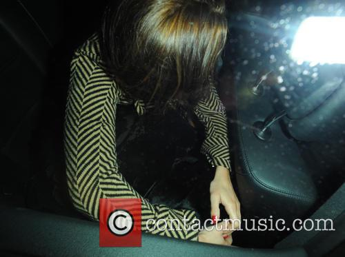Lindsay Lohan Lindsay Lohan's friend covers her with...
