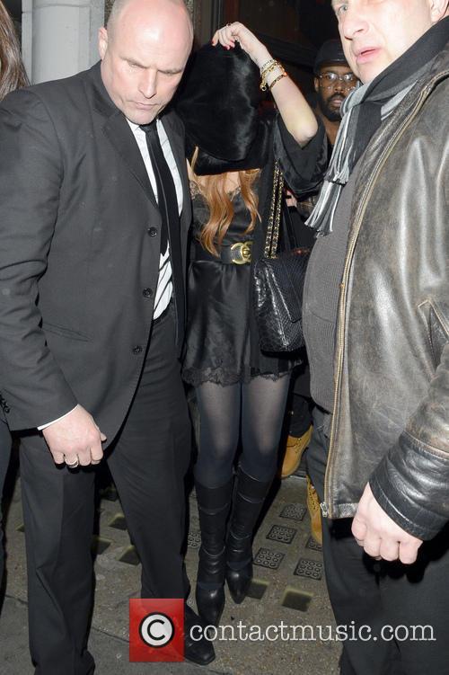 Linsday Lohan leaving a London club, sporting a...