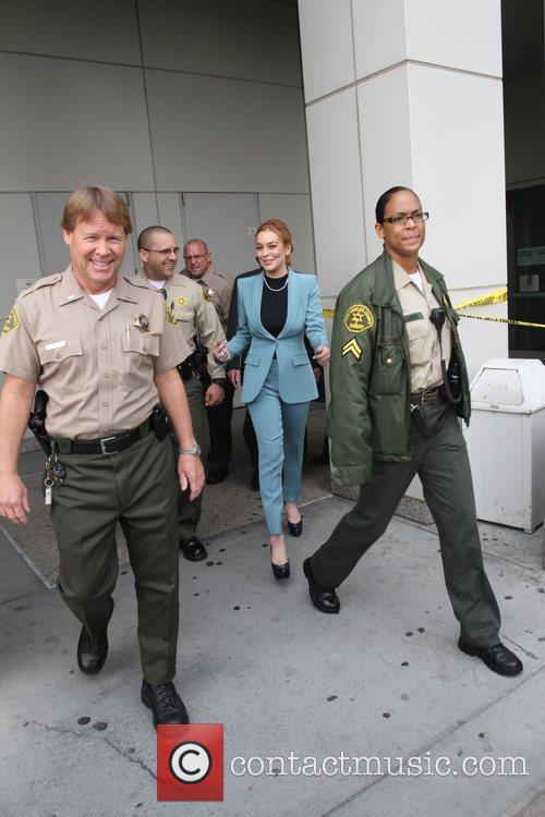 Lindsay Lohan appears in good spirits as she...