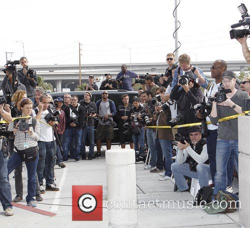 Photographers wait for Lindsay Lohan as she leaves...