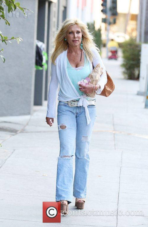 Lisa Gastineau out and about walking in Beverly...