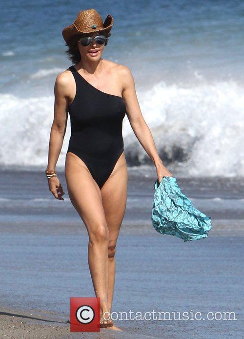 Lisa Rinna takes a walk on the beach...