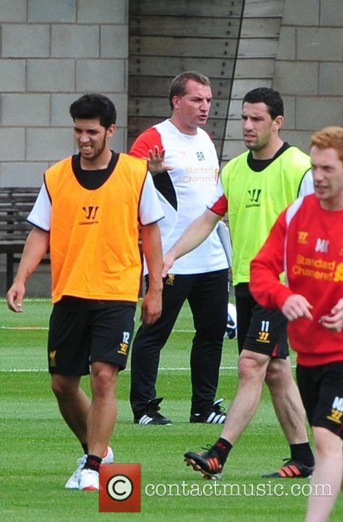 Brendan Rodgers and Maxi Rodriguez Liverpool football team...