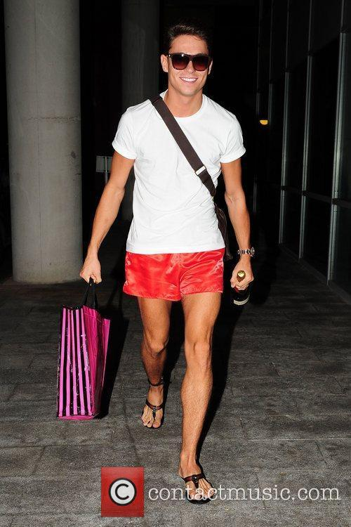 Joey Essex leaving his Liverpool hotel wearing sunglasses...