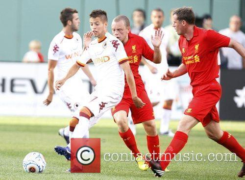 AS Roma's Bogdan Lopez, left, kicks the ball...
