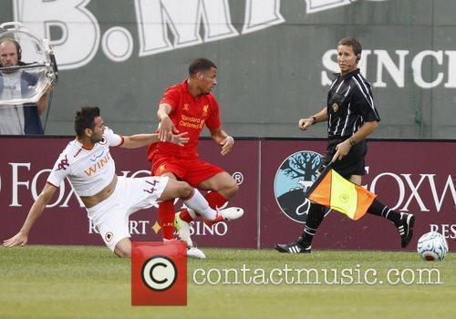 AS Roma's Leandro Castan, left, and Liverpool's Nathan...