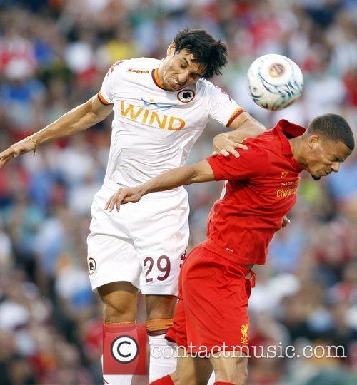 AS Roma's Nicolas Burdisso and Liverpool's Nathan Eccleston...