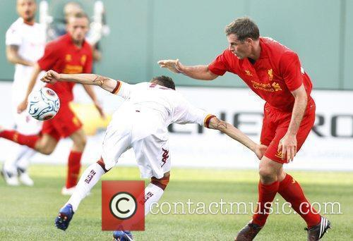 Liverpool's Jamie Carragher, right, and AS Roma's Bogdan...