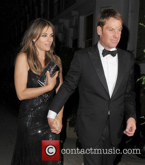 Shane Warne and Elizabeth Hurley return home, following...