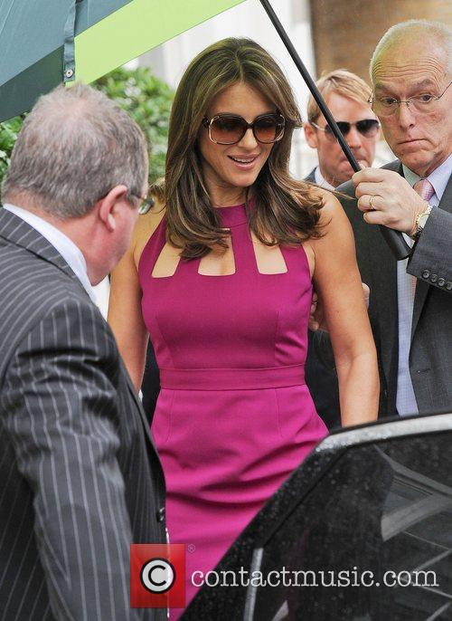 Elizabeth Hurley  leaving home with fiance Shane...