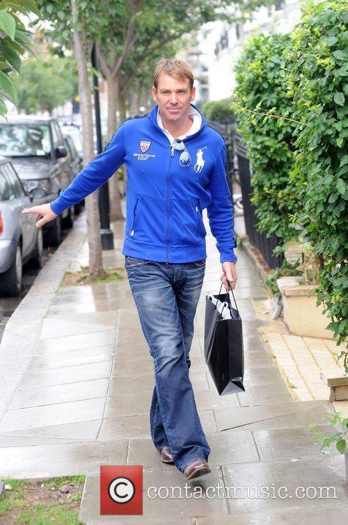 Shane Warne seen arriving at a private residence...