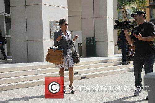 Attorney Shawn Chapman Holley is seen outside the...