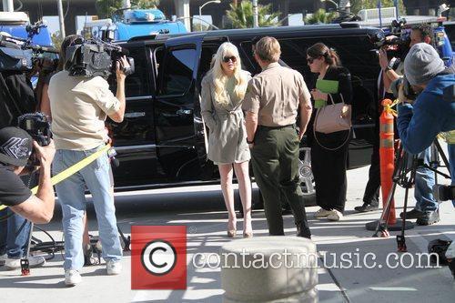 Lindsay Lohan arrives in good spirits at the...