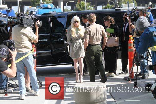 Lindsay Lohan arrives in good spirits at the...