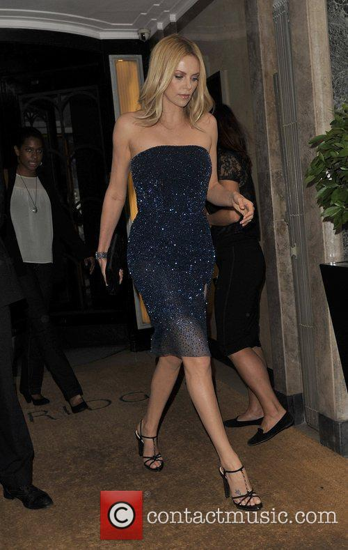 Charlize Theron leaving her London hotel to attend...