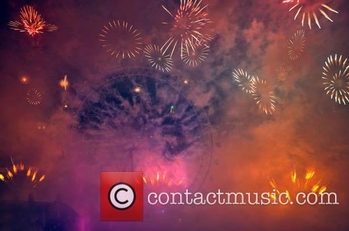 Fireworks displays over the London Eye to mark...