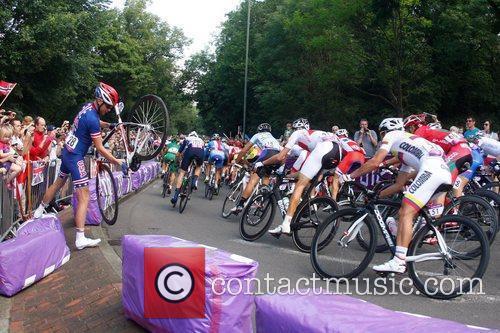 USA cycle rider Timmy Duggan crashes into the...