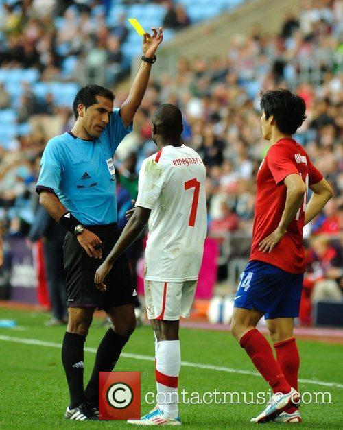 Switzerland's Innocent Emeghara receives a yellow card from...