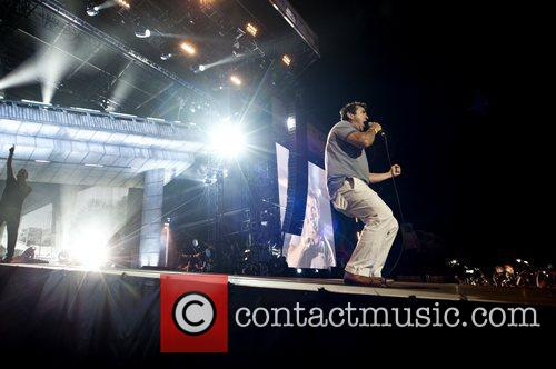 Performs on stage during the BT London Live...