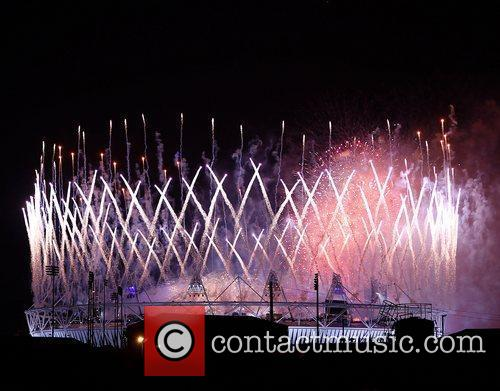 Fireworks explode over the Olympic stadium at the...