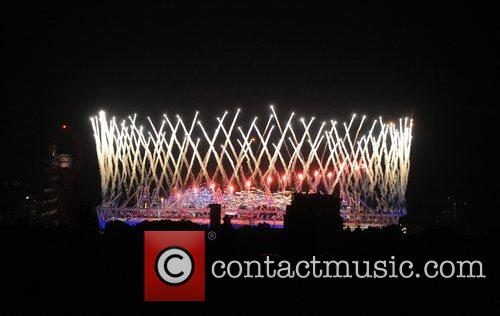 Fireworks ignite over the Olympic Stadium during the...