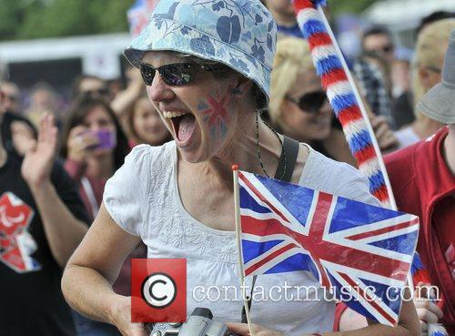 Crowds celebrate Andy Murray winning the Olympic tennis...