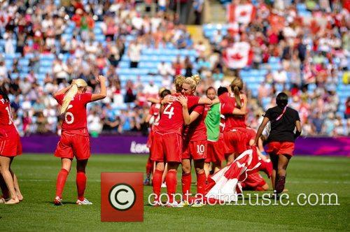 Canada's players celebrate after the women's football football...