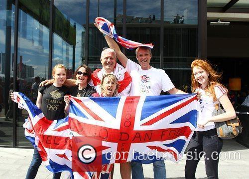 Family of Dan Fogg celebrate after he swam...