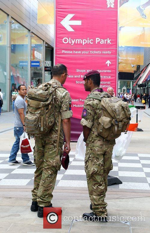 Soldiers heading for Olympic Park on the first...
