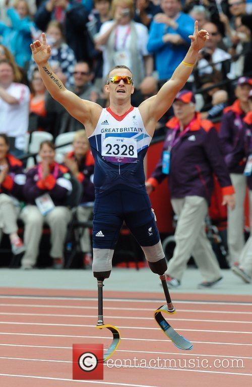 Wins Gold and breaks the world record in...