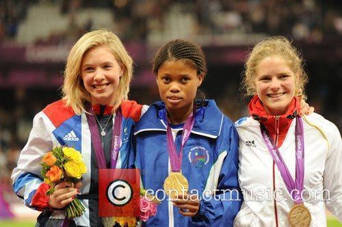 Johanna Benson (gold) Bethany Woodward (silver) Maria Seifert...