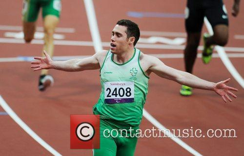 Wins Gold during the Men's 100m T13 Final...