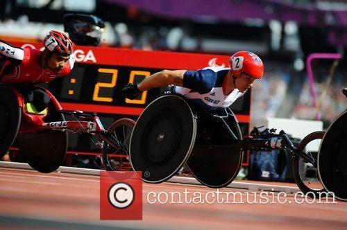 Men's 100m T54 Heat. David Weir (GBR) qualifies...