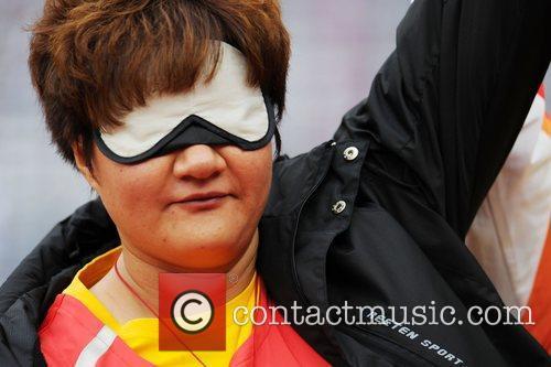 Hongxia Tang (CHN) wins Gold for the Women's...