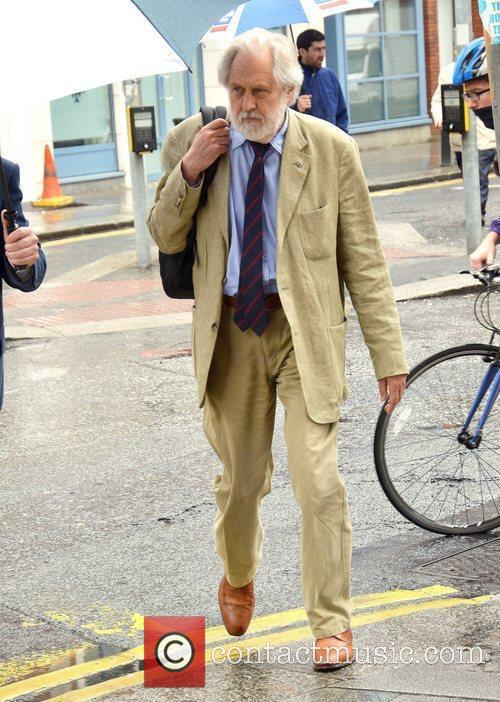 Film producer and politician walking in Dublin City...