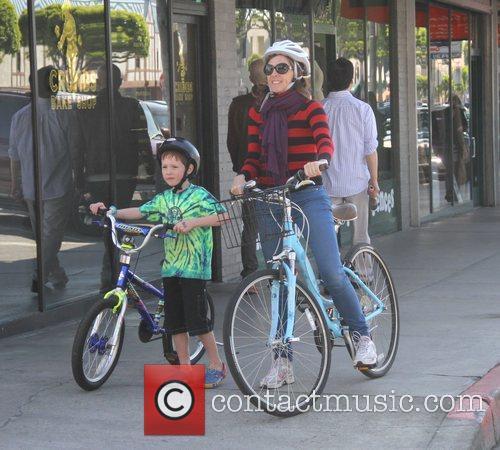 Molly Shannon and her son Nolan  riding...
