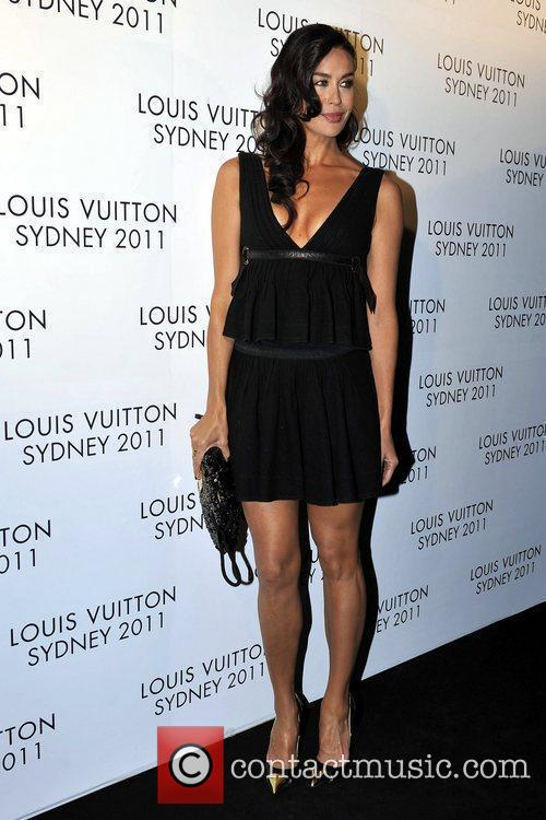 Megan Gale arrives at the instore cocktail party...