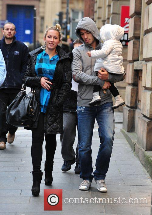 Luis Suarez with his wife Sofia and daughter...