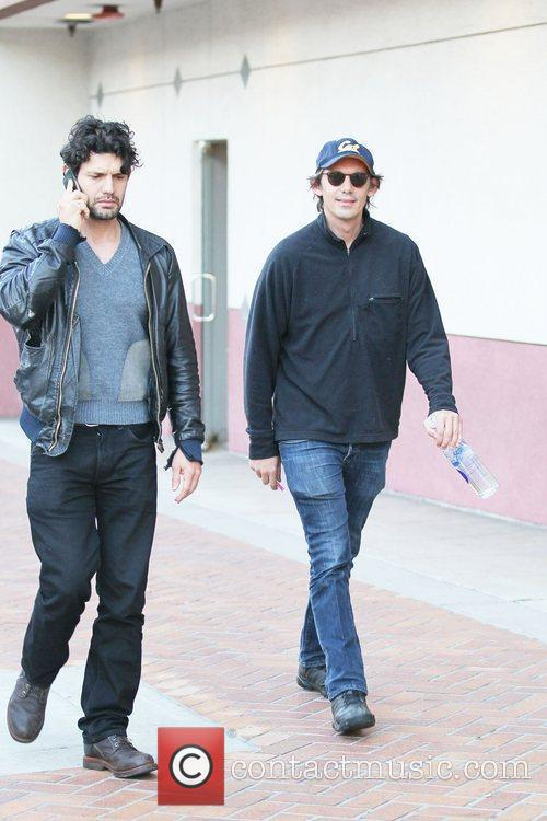 Lukas Haas and a friend outside Rite Aid...