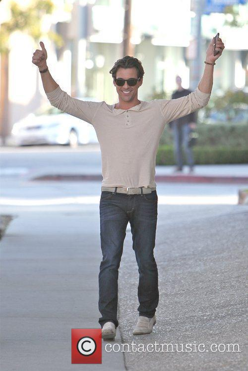 Madison Hildebrand leaving a Men's Suit Store on...