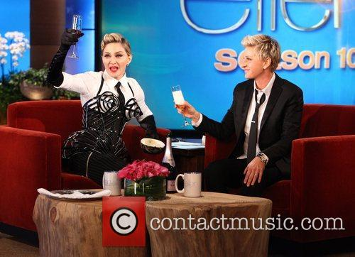 Talk show host Ellen DeGeneres welcomes Madonna for...