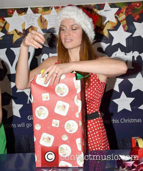 Actress Caroline Morahan partipates in a gift wrapping...