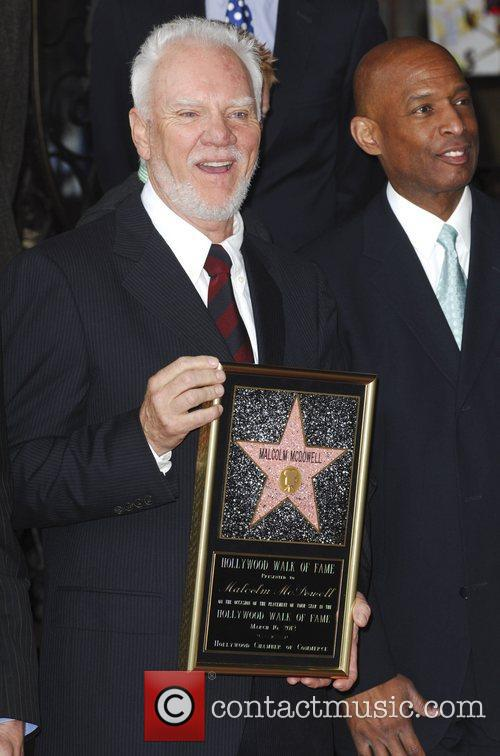 Malcolm McDowell and Guest The Hollywood Walk of...