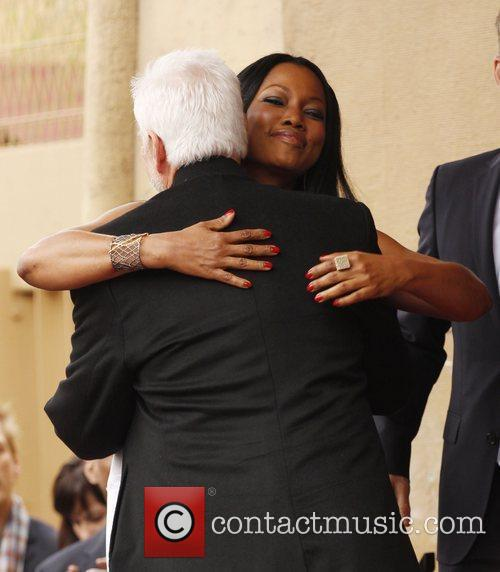 Malcolm McDowell and Garcelle Beauvais The Hollywood Walk...